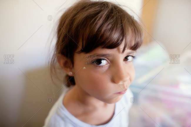 Girl with a paint splatter on her face