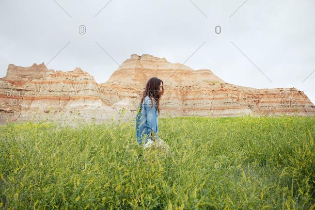 Young woman walking through a field