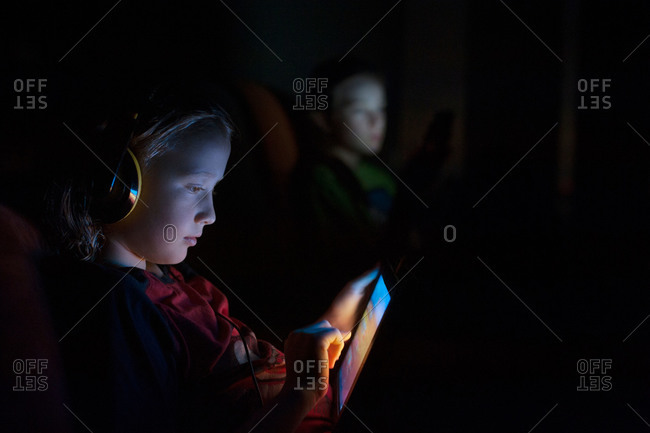 Girl using a smart tablet with headphones