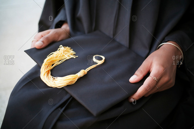 Close-up of a graduate holding their cap
