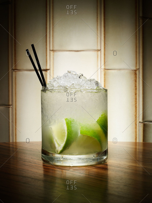 Gin and tonic on ice with limes