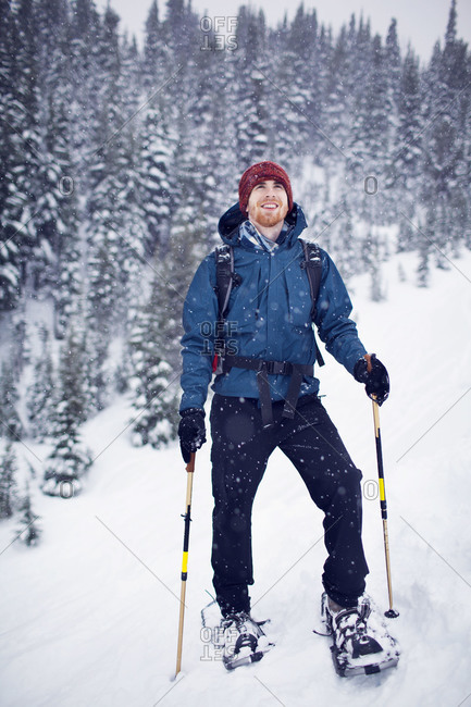Man enjoying snow flakes while snowshoeing