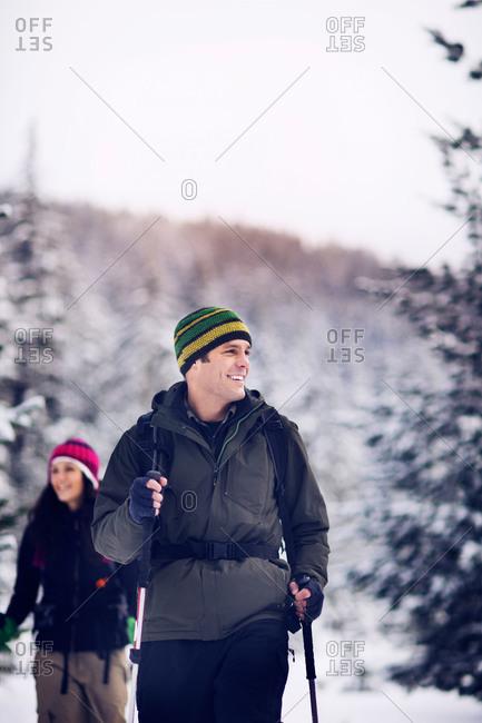 Happy man enjoying snowshoeing