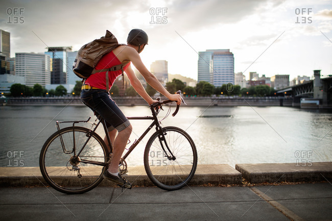 Bicyclist along an urban waterfront