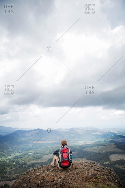 Hiker taking in the view from mountain peak