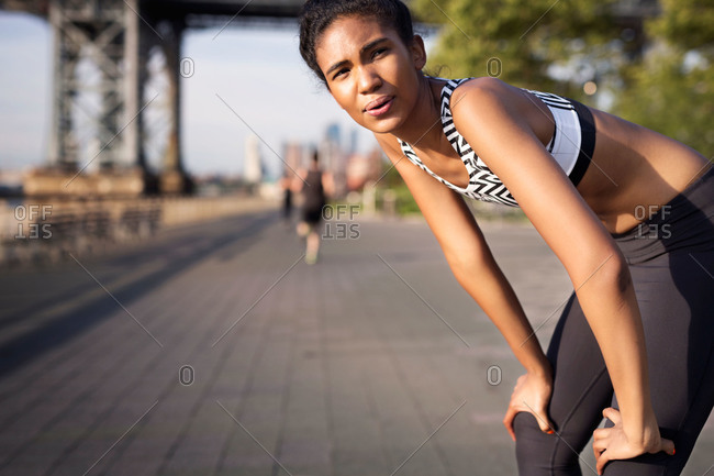 Woman catching her breath after exercising