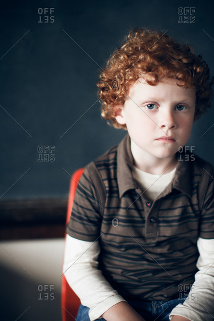 Portrait of a boy with curly red hair