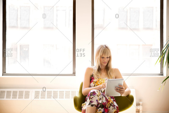 Woman using a smart tablet in an office