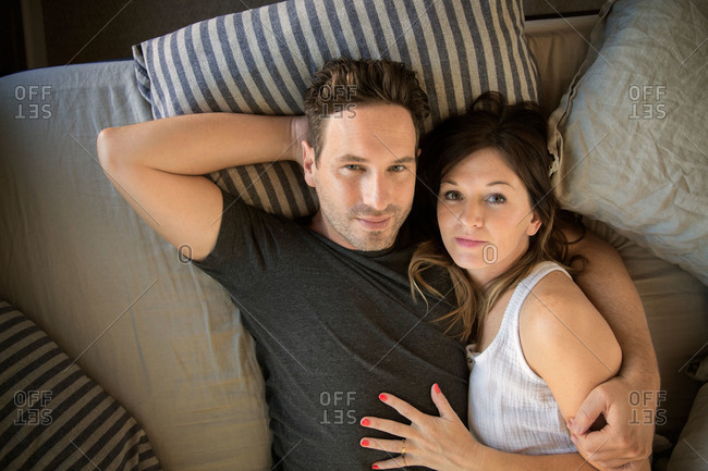 Portrait of a couple relaxing in bed