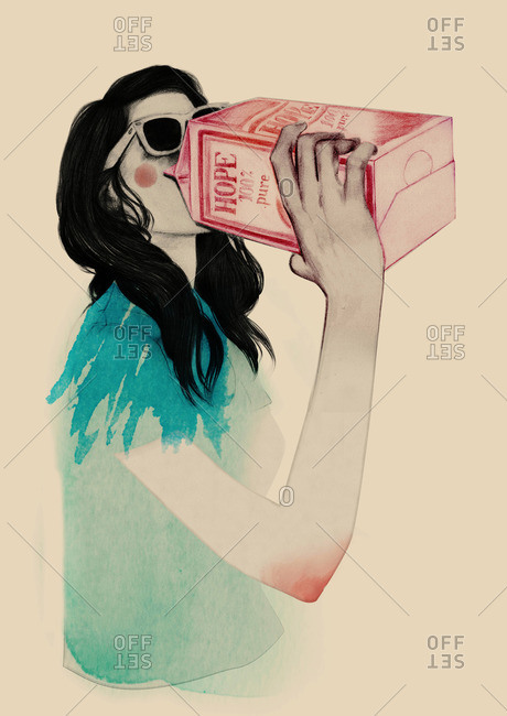 Young woman drinking from a milk carton