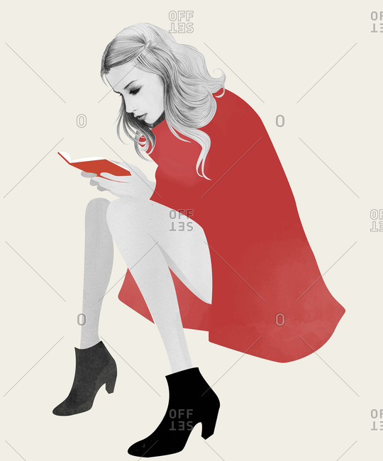 Young woman in red reading a book