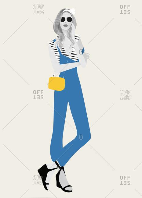 Fashionable woman wearing a blue jumper