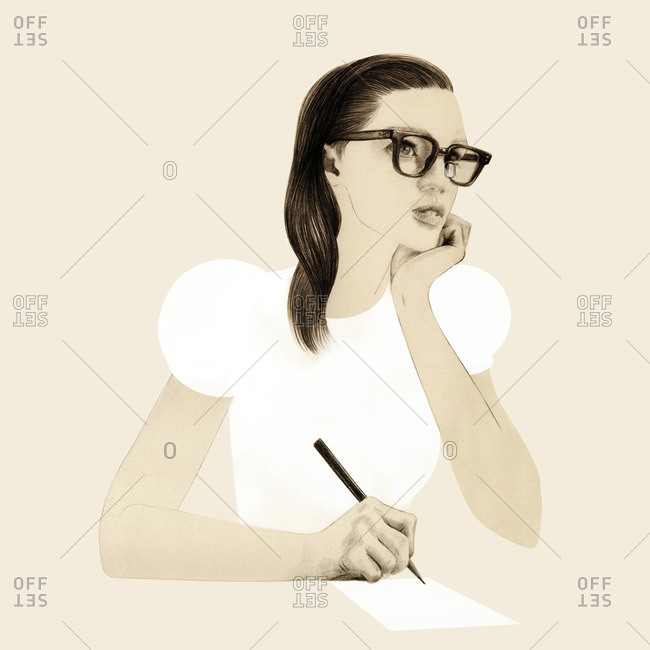 Young woman wearing glasses writing