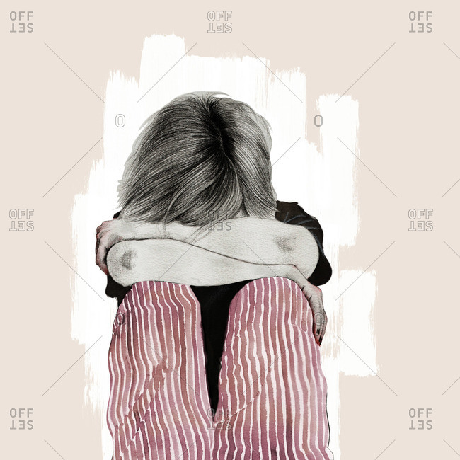 Woman burying her head in her arms
