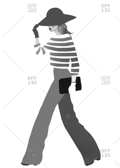 Stylish woman walking with a purse and hat