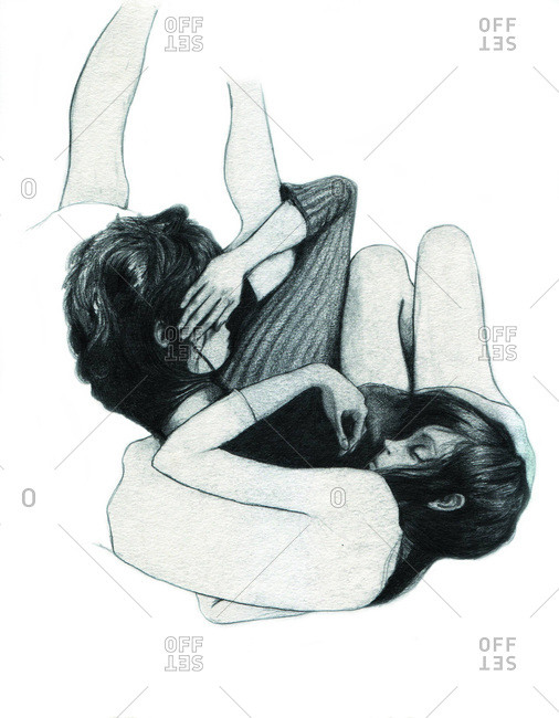 Two women curled up together