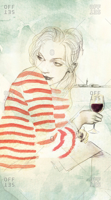Woman in a striped shirt with a glass of red wine
