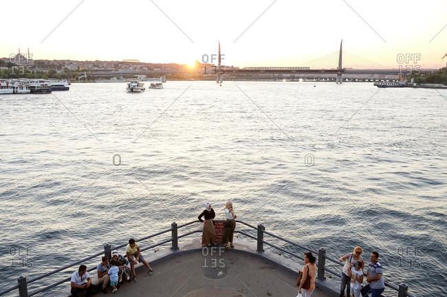Istanbul, Turkey - August 3, 2015: People overlooking Bosphorus Strait in Turkey