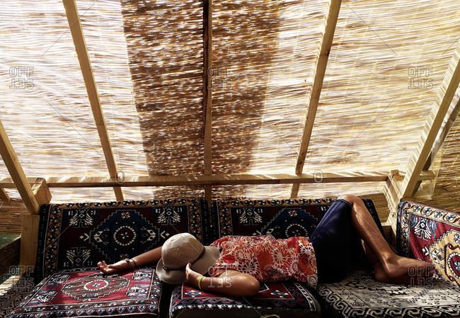 Girl resting in a shelter in Cappadocia, Turkey