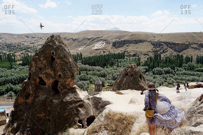 Tourists at rock formations in Cappadocia, Turkey