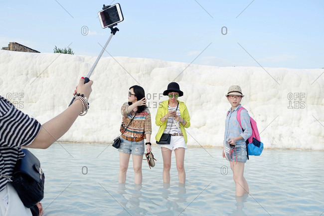 Cappadocia, Turkey - August 8, 2015: Tourists take picture by travertine wall in Pamukkale, Turkey