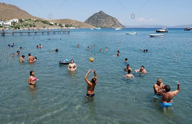 Bodrum, Turkey - August 12, 2015: People swimming in Aegean sea in Turkey