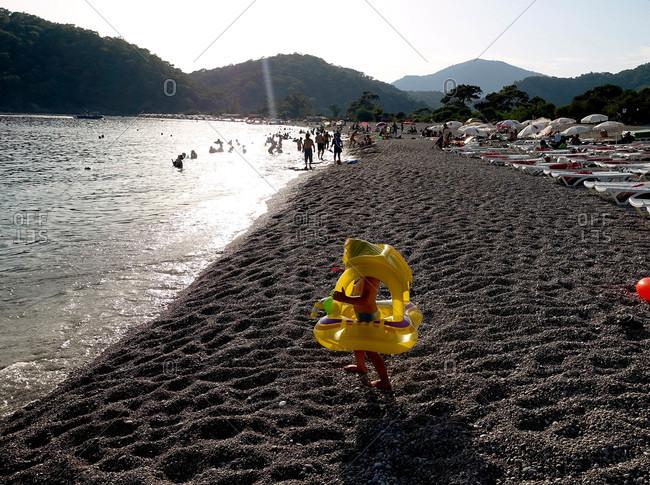 Child with floatie on beach in Turkey