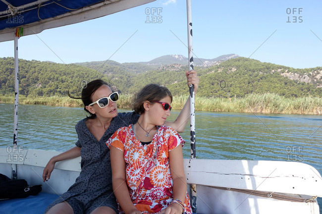 Two woman riding boat in river in Dalyan, Turkey