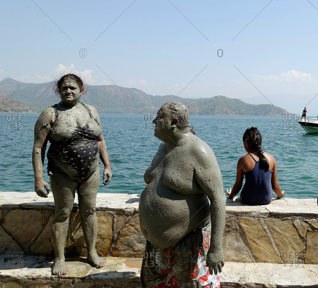 Dalyan, Turkey - August 17, 2015: People covered in mud from baths in Turkey