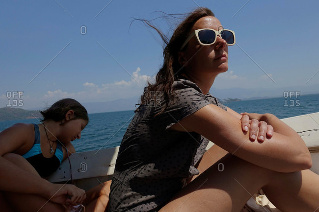 Two woman riding boat along Turkish river, Dalyan, Turkey