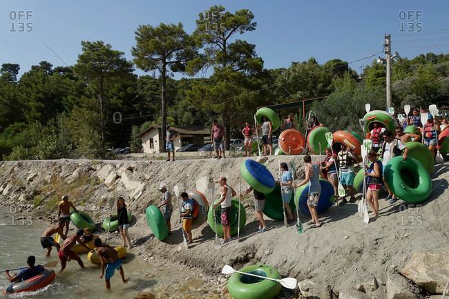 Saklikent Tlos Yakapark, Turkey - August 19, 2015: Crowds with rafts entering river in Turkey