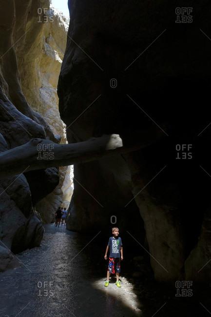 Saklikent Tlos Yakapark, Turkey - August 19, 2015: Boy in shaft of light in a canyon in Turkey
