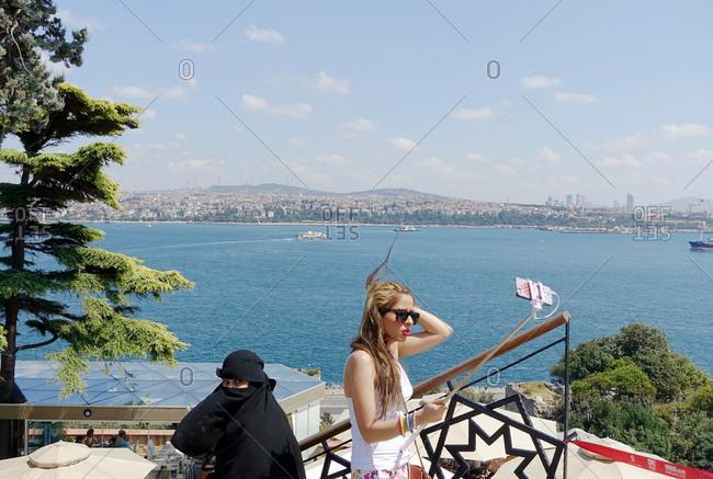 Istanbul, Turkey - August 20, 2015: Woman taking selfie by woman in burqa in Istanbul