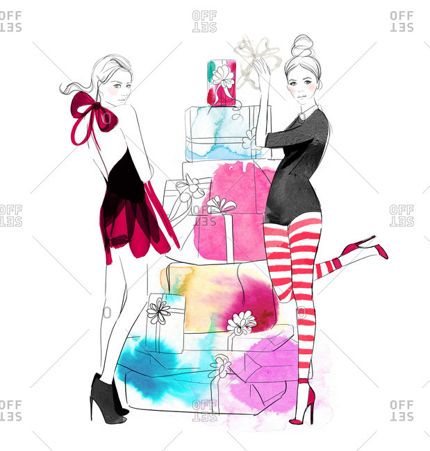 Two stylish women by stack of presents