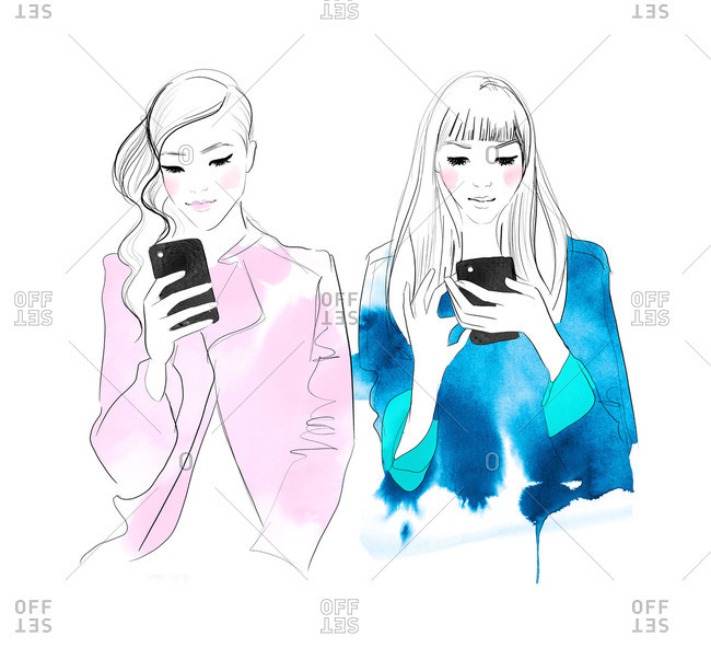 Two stylish women both looking at their phones