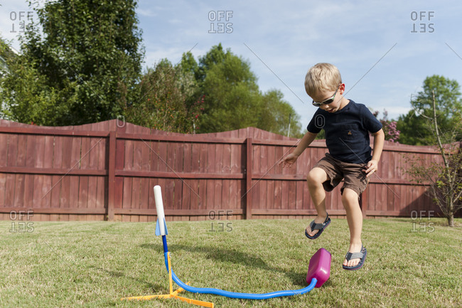 Little boy setting off a toy rocket