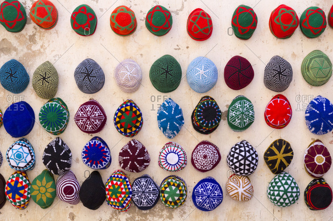 Men's hats (tagiya) hanging on wall, Essaouira, Morocco