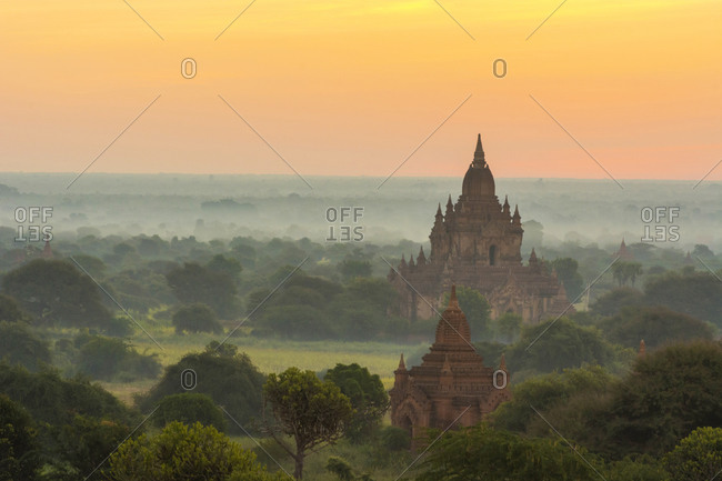 Smoke from cooking fires shrouds the temples of Bagan at sunrise, Bagan, Myanmar