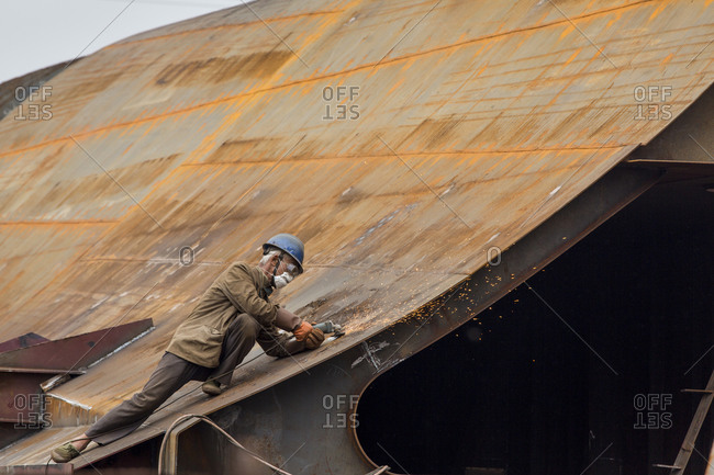 Workmen assembling ships hull at Dong Feng Shipyard, Chongqing, China