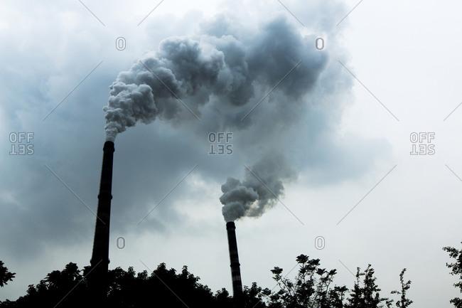Two smoke stacks at a coal fired power plant, Chongqing, China