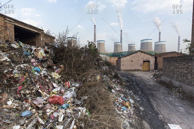 Garbage pile and coal fired power plant, Chongqing, China
