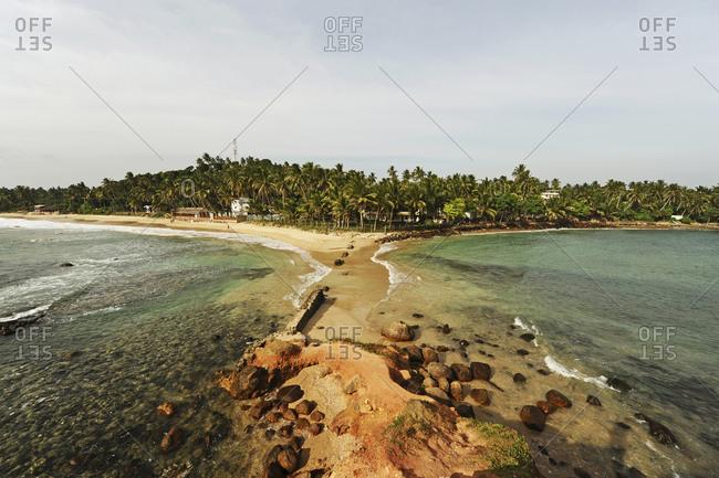 White sand paradise beach with light waves, Mirissa, Sri Lanka