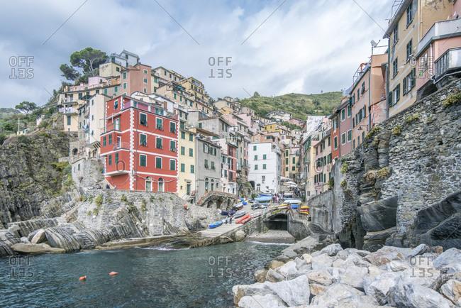 View of the village of Riomaggiore from the sea, in Cinque Terre, Italy