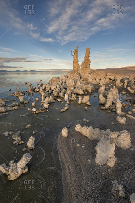 Tufas at sunset with reflection and golden light, Eastern Sierra Nevada Mountains, Mono Lake Tufa Reserve, Lee Vining, California, USA