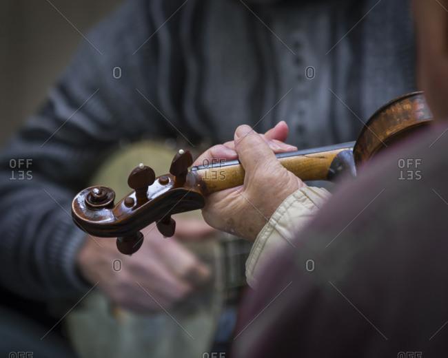 Men playing instruments at the Blue Ridge Music Center, Blue Ridge Parkway, Vinton,Virginia, USA