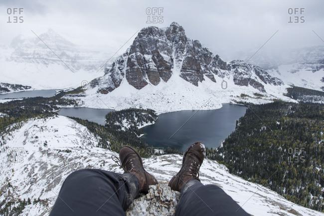 Hiker enjoying a winter view of Mount Assiniboine in Canada