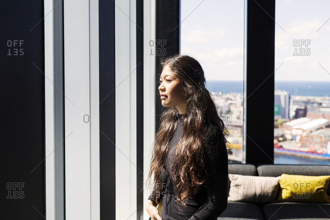Woman enjoying the view from high rise building