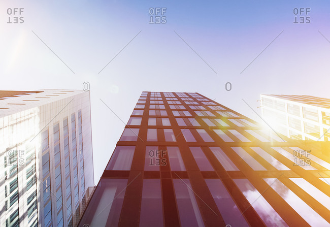 Bright sunshine reflecting in glass facades of modern office buildings