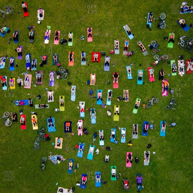 Group yoga in park in Vilnius, Lithuania