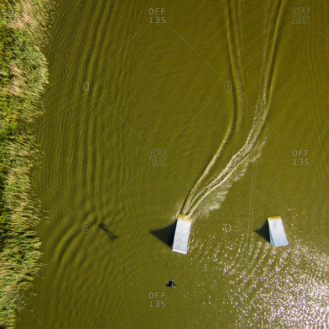 Wakeboarder doing jump in Svencele, Lithuania